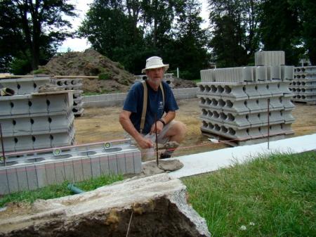 Applying mortar to the footing.
