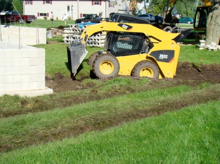Moving topsoil from the location of the future driveway