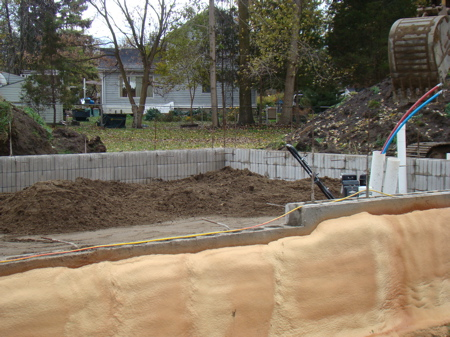 Starting to fill the garage foundation.