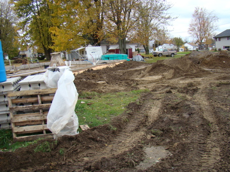The disappearing sand piles, and backfilled clay soil on outside of house foundation.