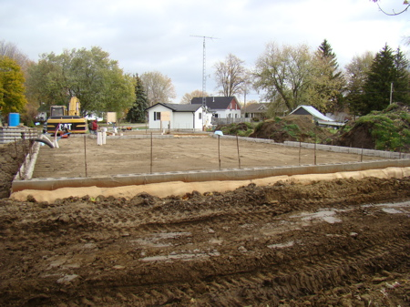 House foundation finished to the level where plumbing and  slab components are installed.