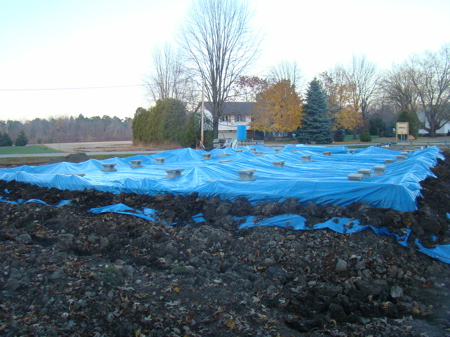 Southwest corner of foundation, with tarp in place.
