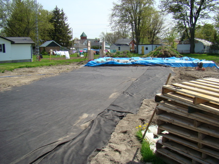 "Compacted sand with ""driveway fabric"" in place"