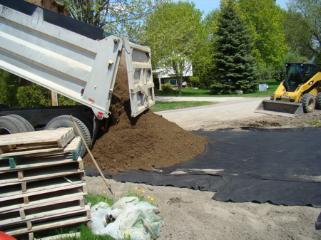 Dumping the gravel at the front of the driveway.
