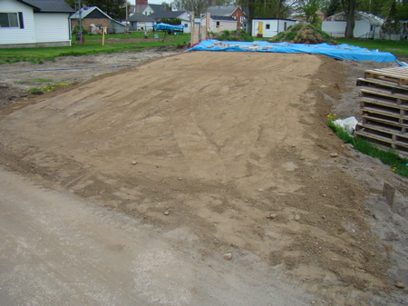 The finished compacted gravel driveway.
