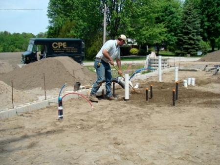 Kelly putting the sand back in place after the inspection.