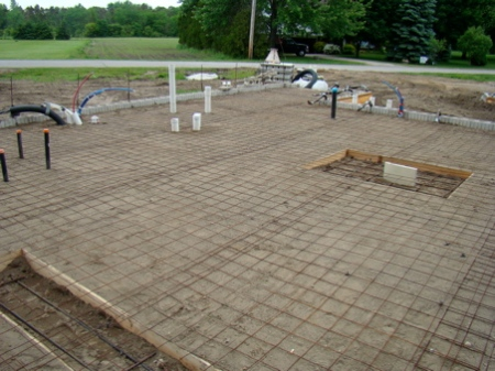 Reinforcing steel mesh in place on the house slab pad.