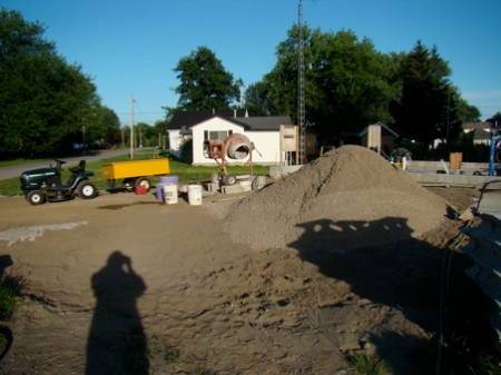 The cement mixing station, on the driveway with gravel on the fill between garage and house.
