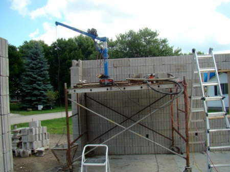"July 26, View of the scaffold and ""skyhook"" ready to begin pour of the east wall."