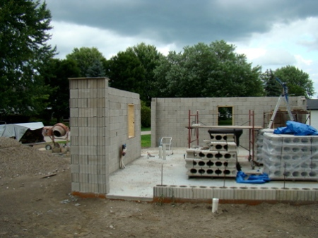 Finished, poured, north and east walls. Bond beam will be poured later.