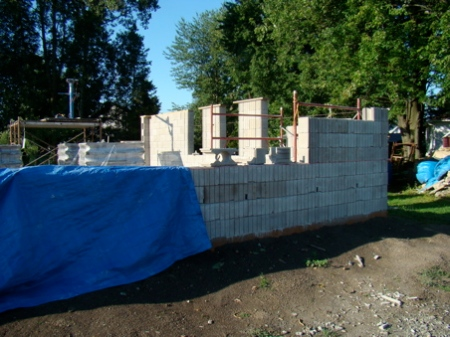 Looking across the north wall at the west wall and scaffolds in place.