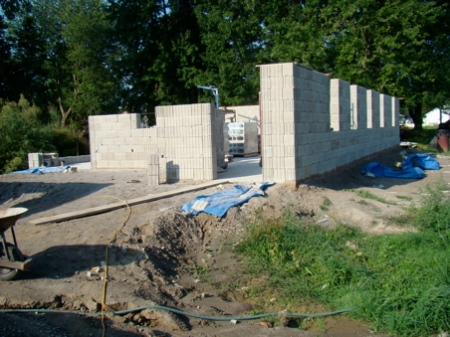 Monday August 24, north wall to top of window, ready for frames, only 3 more courses for the east wall to the same level.