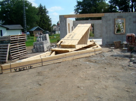 The garage roof trusses arrived as well just as we were nearing completion on the house wall.