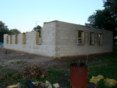 August 29, Sunday, West wall stacked, all window frames in 3 walls, East end and West end of North wall stacked to top
