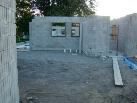 East wall complete to top except for one course on top of entry wall. Tomorrow the door frame and rebar into the wall columns.
