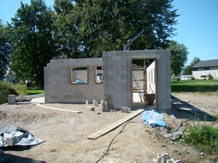 Thursday Sept 3, East wall of the house stacked, cement in columns and lintels.