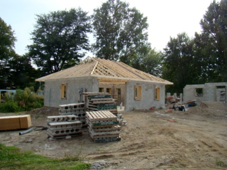 Garage trusses complete, looking from the end of the driveway.