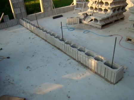 Base course of blocks and rebar for the bedroom wall.