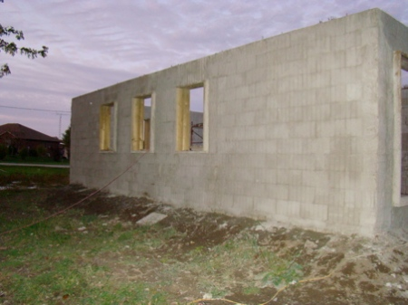 October 9, SBC complete west outer wall of house.