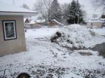Snow on my stockpiles of topsoil, eventually to be used for landscaping.