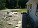 Setting up to make patio blocks, pallets with plywood on the driveway next to the gravel pile.