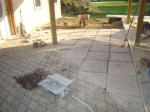 Patio blocks laid in the space between workshop and screen porch platform.