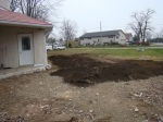 Some of the topsoil carried around to even out the front yard