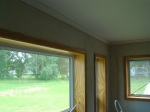 South facing trim and window frames stained and varnished in workshop