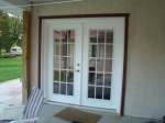 Aluminimum fascia and trim installed on French doors to kitchen dinining area.