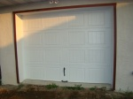 Cement board trim installed around garage door frame.